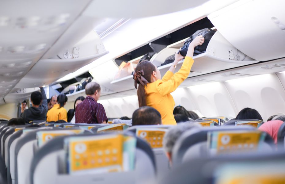 Cabin crew checking overhead bins