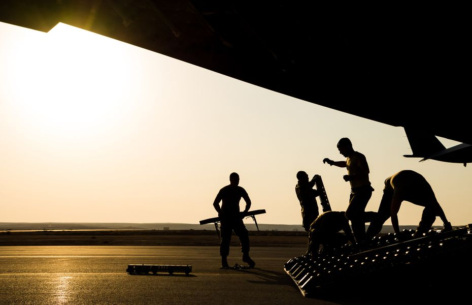 Troops loading cargo in to aircraft